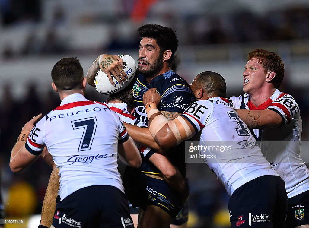 James Tamou of the Cowboys is wrapped by the Roosters defence during the round three NRL match between the North Queensland Cowboys and the Sydney Roosters at 1300SMILES Stadium on March 17, 2016 in Townsville, Australia.
