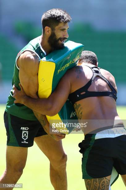 James Tamou of the New Zealand Maori All Stars holds the is tackle bag for team mates during the NRL All Stars Media Opportunity at AAMI Park on...