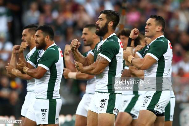 James Tamou of the New Zealand Maori Kiwis performs the Haka with team mates during the NRL exhibition match between the Indigenous All Stars and the...