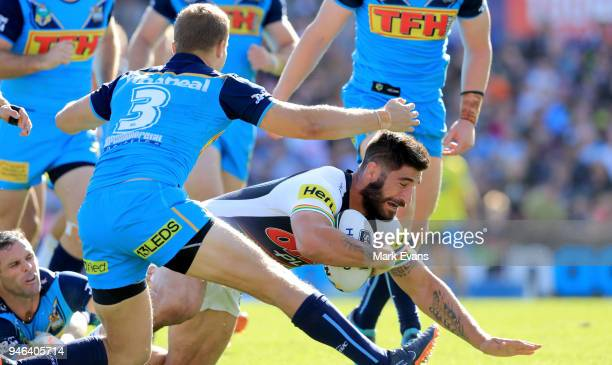 James Tamou of the Panthers forces his way through the Titans defence to score a tryduring the round six NRL match between the Penrith Panthers and...