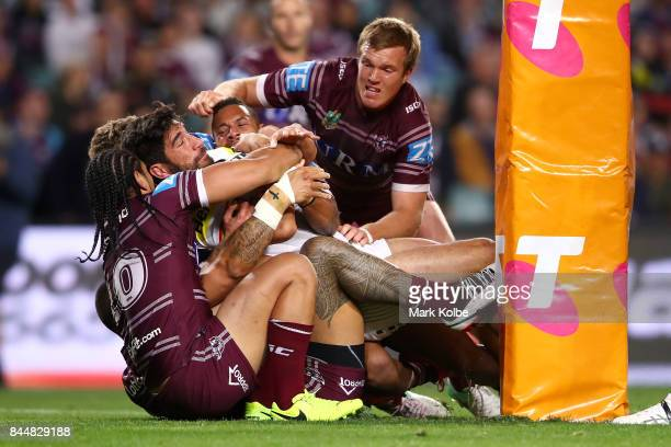 James Tamou of the Panthers is held up over the try line during the NRL Elimination Final match between the Manly Sea Eagles and the Penrith Panthers...