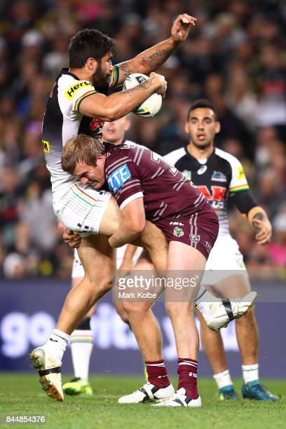 James Tamou of the Panthers is tackled by Jake Trbojevic of the Sea Eagles during the NRL Elimination Final match between the Manly Sea Eagles and...