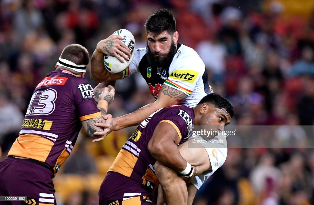 James Tamou of the Panthers is tackled by Tevita Pangai of the Broncos during the round 19 NRL match between the Brisbane Broncos and the Penrith Panthers at Suncorp Stadium on July 20, 2018 in Brisbane, Australia.