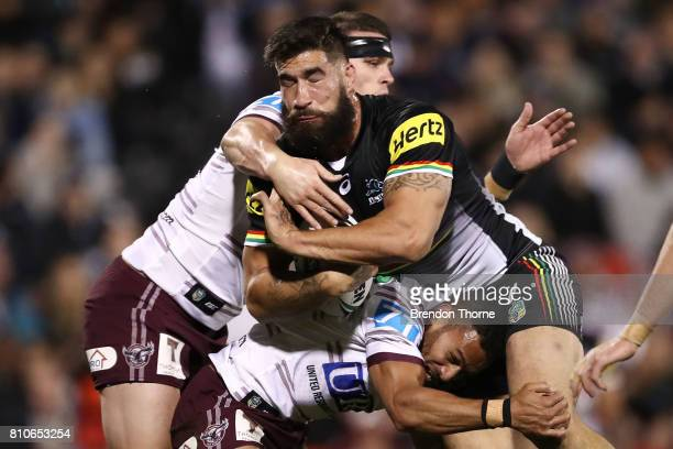 James Tamou of the Panthers is tackled by the Sea Eagles defence during the round 18 NRL match between the Penrith Panthers and the Manly Sea Eagles...