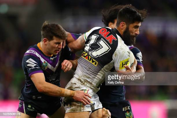 James Tamou of the Panthers is tackled by the Storm defence during the round 25 NRL match between the Melbourne Storm and the Penrith Panthers at...