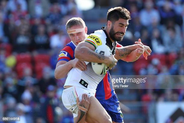 James Tamou of the Panthers is tackled during the round 11 NRL match between the Newcastle Knights and the Penrith Panthers at McDonald Jones Stadium...