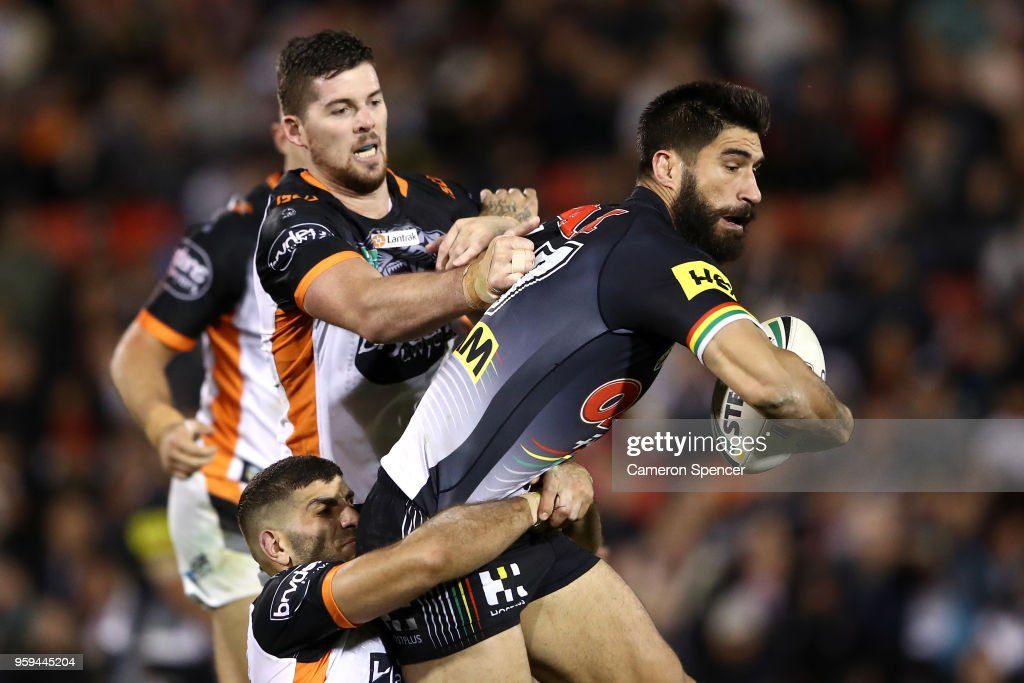 James Tamou of the Panthers is tackled during the round 11 NRL match between the Penrith Panthers and the Wests Tigers at Panthers Stadium on May 17, 2018 in Penrith, Australia.
