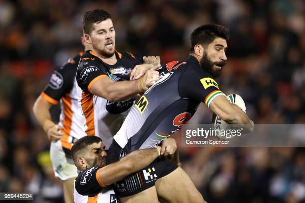 James Tamou of the Panthers is tackled during the round 11 NRL match between the Penrith Panthers and the Wests Tigers at Panthers Stadium on May 17...