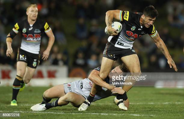 James Tamou of the Panthers is tackled during the round 23 NRL match between the Penrith Panthers and the North Queensland Cowboys at Pepper Stadium...