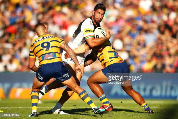 James Tamou of the Panthers is tackled during the round one NRL match between the Penrith Panthers and the Parramatta Eels at Panthers Stadium on...
