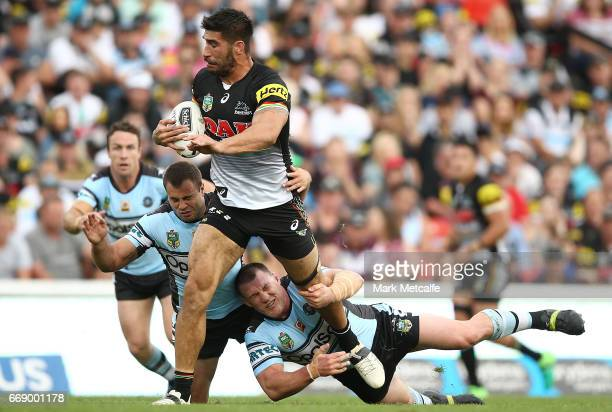 James Tamou of the Panthers is tackled during the round seven NRL match between the Penrith Panthers and the Cronulla Sharks at Pepper Stadium on...