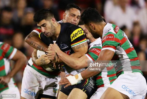 James Tamou of the Panthers is tackled during the round six NRL match between the Penrith Panthers and the South Sydney Rabbitohs at Pepper Stadium...