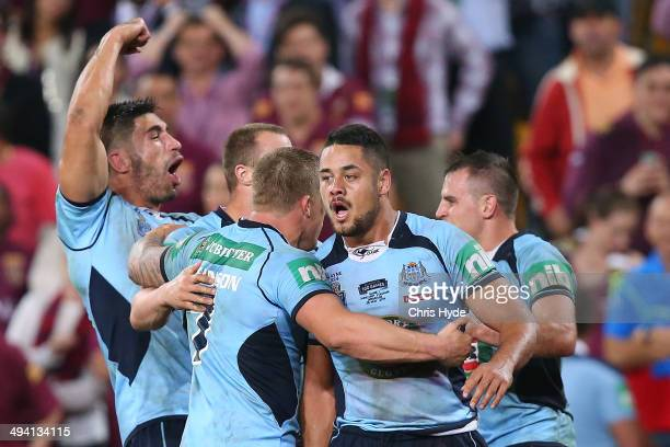 James Tamou Trent Hodkinson and Jarryd Hayne of the Blues celebrate after winning game one of the State of Origin series between the Queensland...