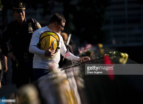 James Taormina whose brother Dennis was killed in the 9/11 attacks pauses at the memorial before a commemoration ceremony for the victims of the...