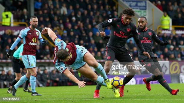 James Tarkowski of Burnley and Alex Iwobi of Arsenal in action during the Premier League match between Burnley and Arsenal at Turf Moor on November...