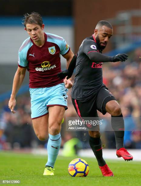 James Tarkowski of Burnley and Alexandre Lacazette of Arsenal during the Premier League match between Burnley and Arsenal at Turf Moor on November 26...