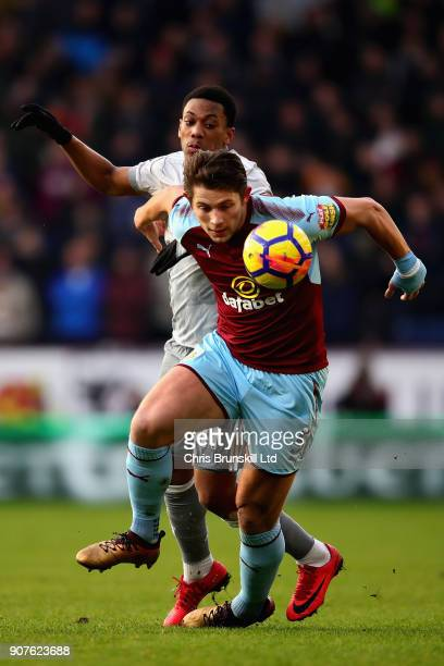 James Tarkowski of Burnley and Anthony Martial of Manchester United battle for the ball during the Premier League match between Burnley and...