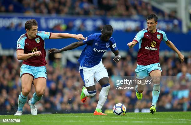James Tarkowski of Burnley and Jack Cork of Burnley attempt to tackle Oumar Niasse of Everton during the Premier League match between Everton and...