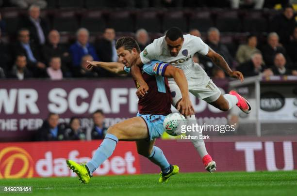 James Tarkowski of Burnley and JayRoy Grot of Leeds compete for the ball during the Carabao Cup Third Round match between Burnley and Leeds United at...
