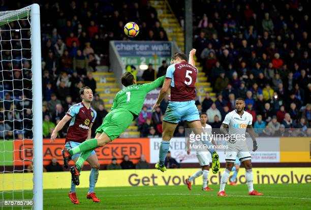 James Tarkowski of Burnley and Lukasz Fabianski of Swansea City compete for the ball during the Premier League match between Burnley and Swansea City...