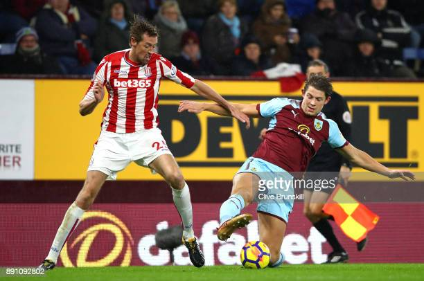 James Tarkowski of Burnley and Peter Crouch of Stoke City during the Premier League match between Burnley and Stoke City at Turf Moor on December 12...