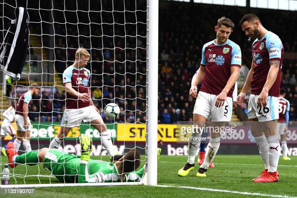 James Tarkowski of Burnley and Phillip Bardsley of Burnley react to Crystal Palace scoring during the Premier League match between Burnley FC and...