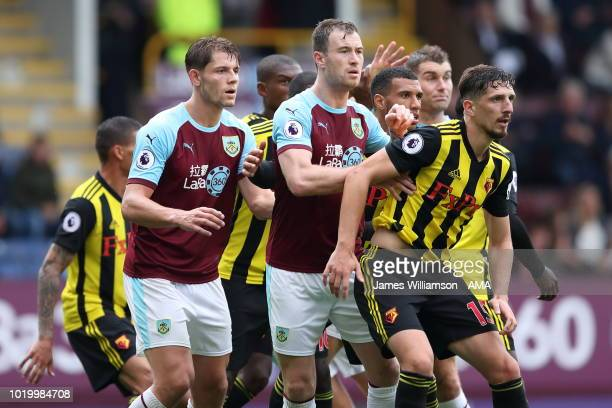 James Tarkowski of Burnley and Sam Vokes of Burnley and Craig Cathcart of Watford wait for a corner to be delivered during the Premier League match...