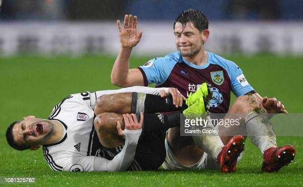 James Tarkowski of Burnley apologises after challenging Aleksandar Mitrovic of Fulham who reacts during the Premier League match between Burnley FC...
