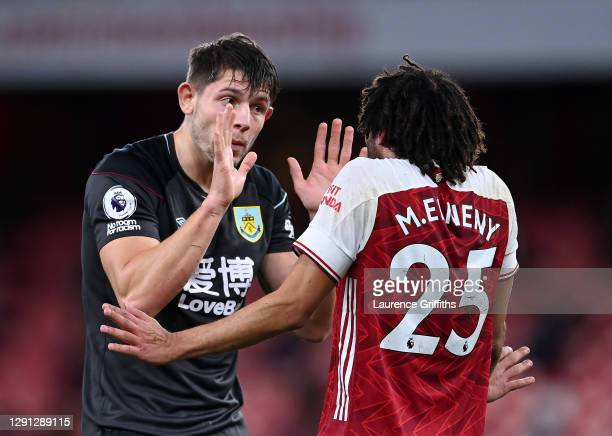 James Tarkowski of Burnley argues with Mohamed Elneny of Arsenal after an incident in the penalty area during the Premier League match between...