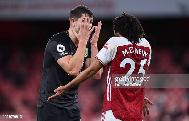 James Tarkowski of Burnley argues with Mohamed Elneny of Arsenal during the Premier League match between Arsenal and Burnley at Emirates Stadium on...