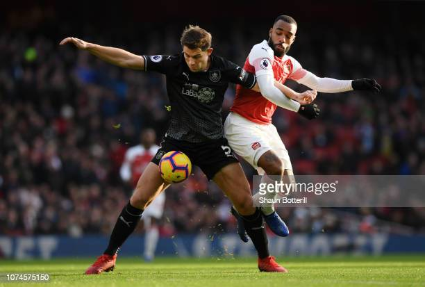 James Tarkowski of Burnley battles for possession with Alexandre Lacazette of Arsenal during the Premier League match between Arsenal FC and Burnley...