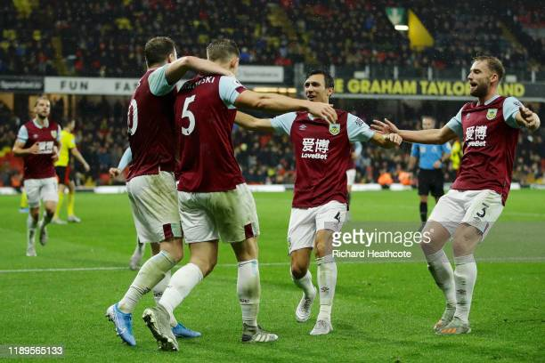 James Tarkowski of Burnley celebrates after scoring his team's third goal during the Premier League match between Watford FC and Burnley FC at...