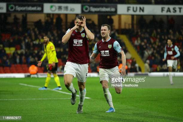 James Tarkowski of Burnley celebrates with teammate Ashley Barnes after scoring his team's third goal during the Premier League match between Watford...