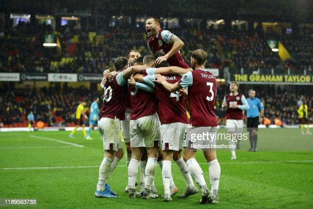 James Tarkowski of Burnley celebrates with teammates after scoring his team's third goal during the Premier League match between Watford FC and...
