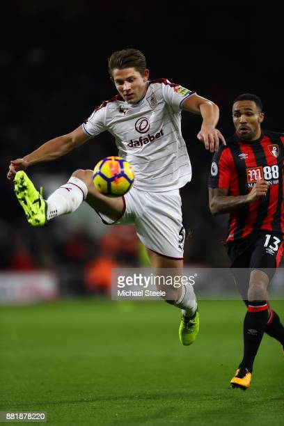 James Tarkowski of Burnley clears from Callum Wilson of Bournemouth during the Premier League match between AFC Bournemouth and Burnley at Vitality...