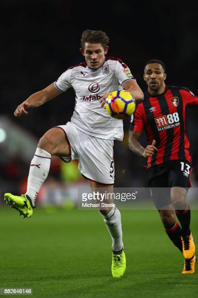 James Tarkowski of Burnley clears from Callum Wilson of Bournemouth during the Premier League match between AFC Bournemouth and Burnley at the...