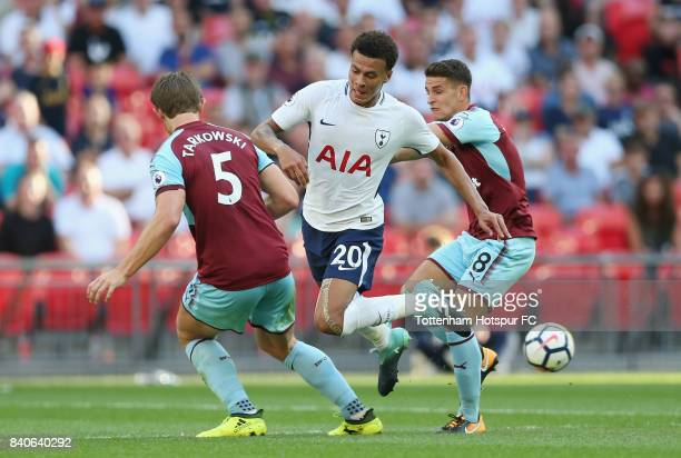 James Tarkowski of Burnley Dele Alli of Tottenham Hotspur and Dean Marney of Burnley during the Premier League match between Tottenham Hotspur and...