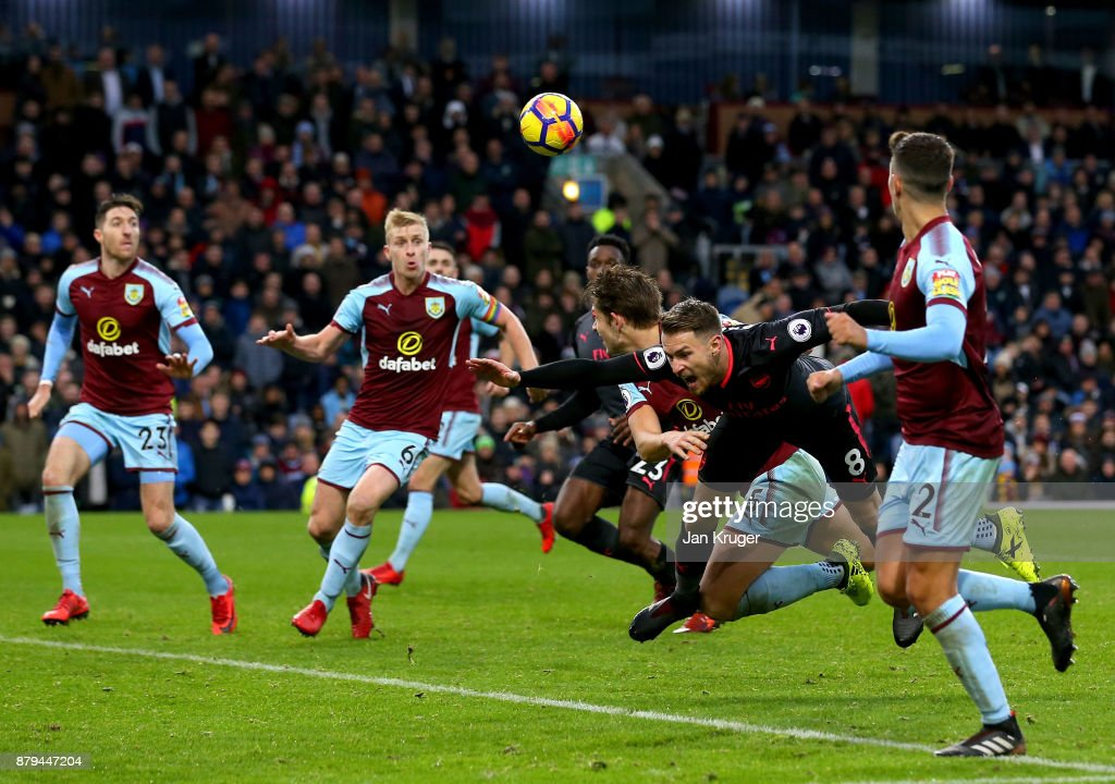 James Tarkowski of Burnley fouls Aaron Ramsey of Arsenal which led to a penalty during the Premier League match between Burnley and Arsenal at Turf Moor on November 26, 2017 in Burnley, England.