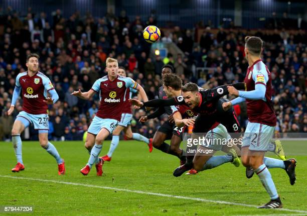 James Tarkowski of Burnley fouls Aaron Ramsey of Arsenal which led to a penalty during the Premier League match between Burnley and Arsenal at Turf...