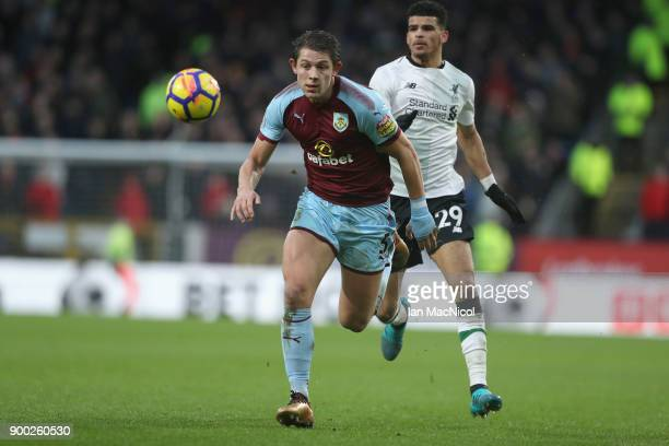 James Tarkowski of Burnley gets away from Dominic Solanke of Liverpool during the Premier League match between Burnley and Liverpool at Turf Moor on...