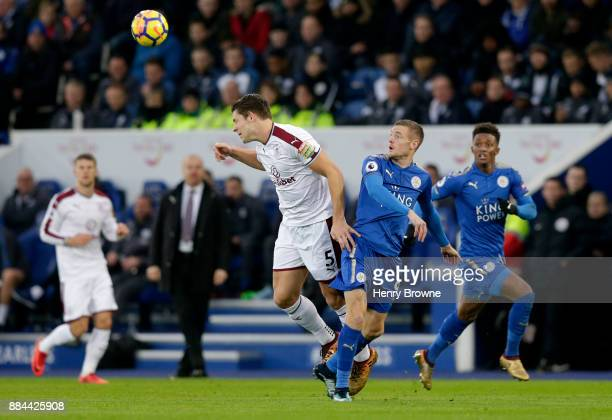 James Tarkowski of Burnley heads away from Jamie Vardy of Leicester City during the Premier League match between Leicester City and Burnley at The...