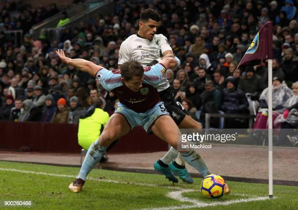 James Tarkowski of Burnley is challenged by Dominic Solanke of Liverpool during the Premier League match between Burnley and Liverpool at Turf Moor...