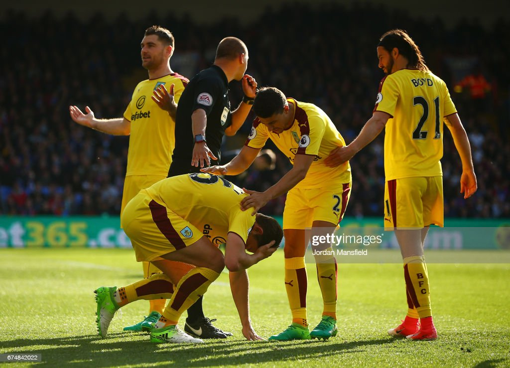 James Tarkowski of Burnley is hit by an object during the Premier League match between Crystal Palace and Burnley at Selhurst Park on April 29, 2017 in London, England.
