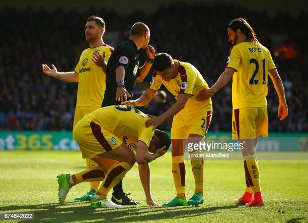 James Tarkowski of Burnley is hit by an object during the Premier League match between Crystal Palace and Burnley at Selhurst Park on April 29 2017...