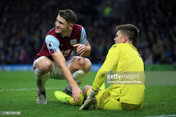 James Tarkowski of Burnley looks concerned for Burnley goalkeeper Nick Pope during the Premier League match between Burnley FC and Manchester United...