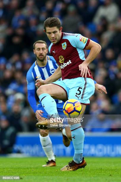 James Tarkowski of Burnley passes the ball during the Premier League match between Brighton and Hove Albion and Burnley at Amex Stadium on December...