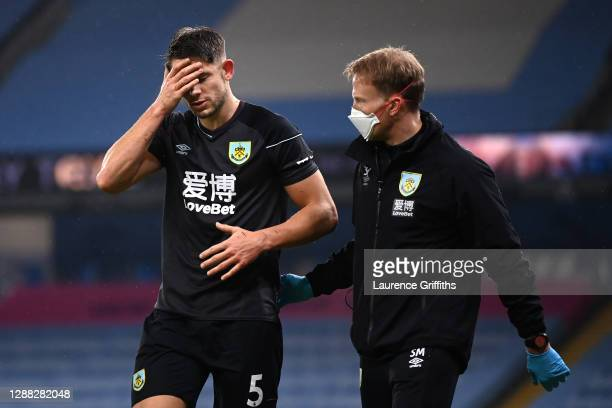James Tarkowski of Burnley receives medical treatment during the Premier League match between Manchester City and Burnley at Etihad Stadium on...