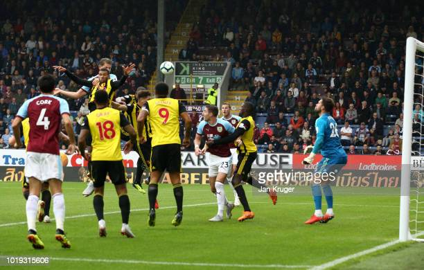 James Tarkowski of Burnley scores his team's first goal during the Premier League match between Burnley FC and Watford FC at Turf Moor on August 19...