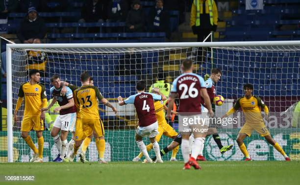 James Tarkowski of Burnley scores his team's first goal during the Premier League match between Burnley FC and Brighton Hove Albion at Turf Moor on...