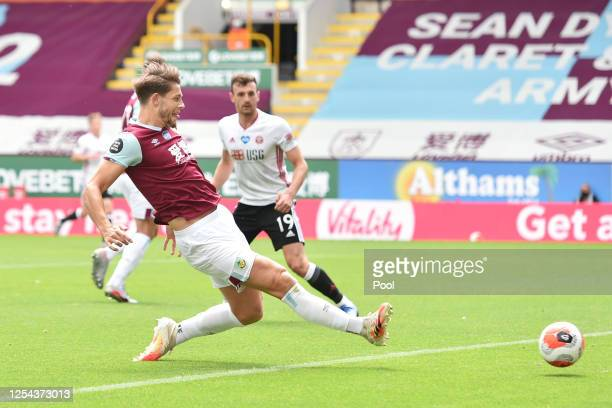 James Tarkowski of Burnley scores his team's first goal during the Premier League match between Burnley FC and Sheffield United at Turf Moor on July...